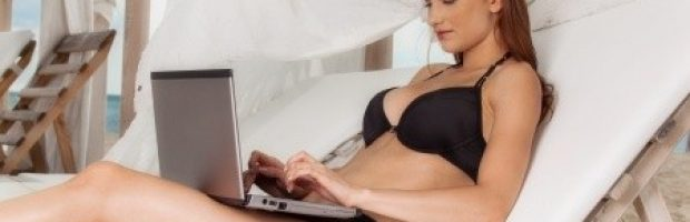 woman in bikini with laptop